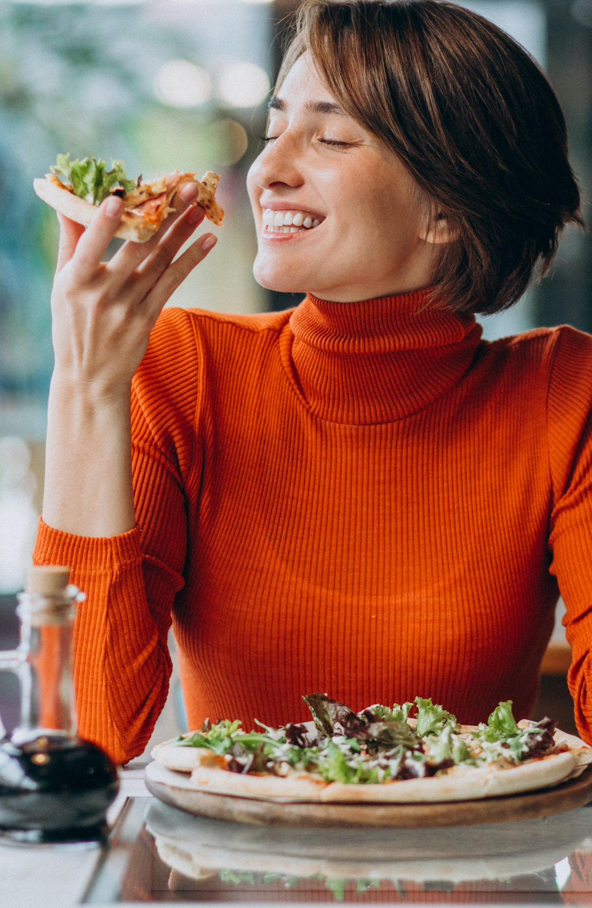 young-pretty-woman-eating-pizza-at-pizza-bar