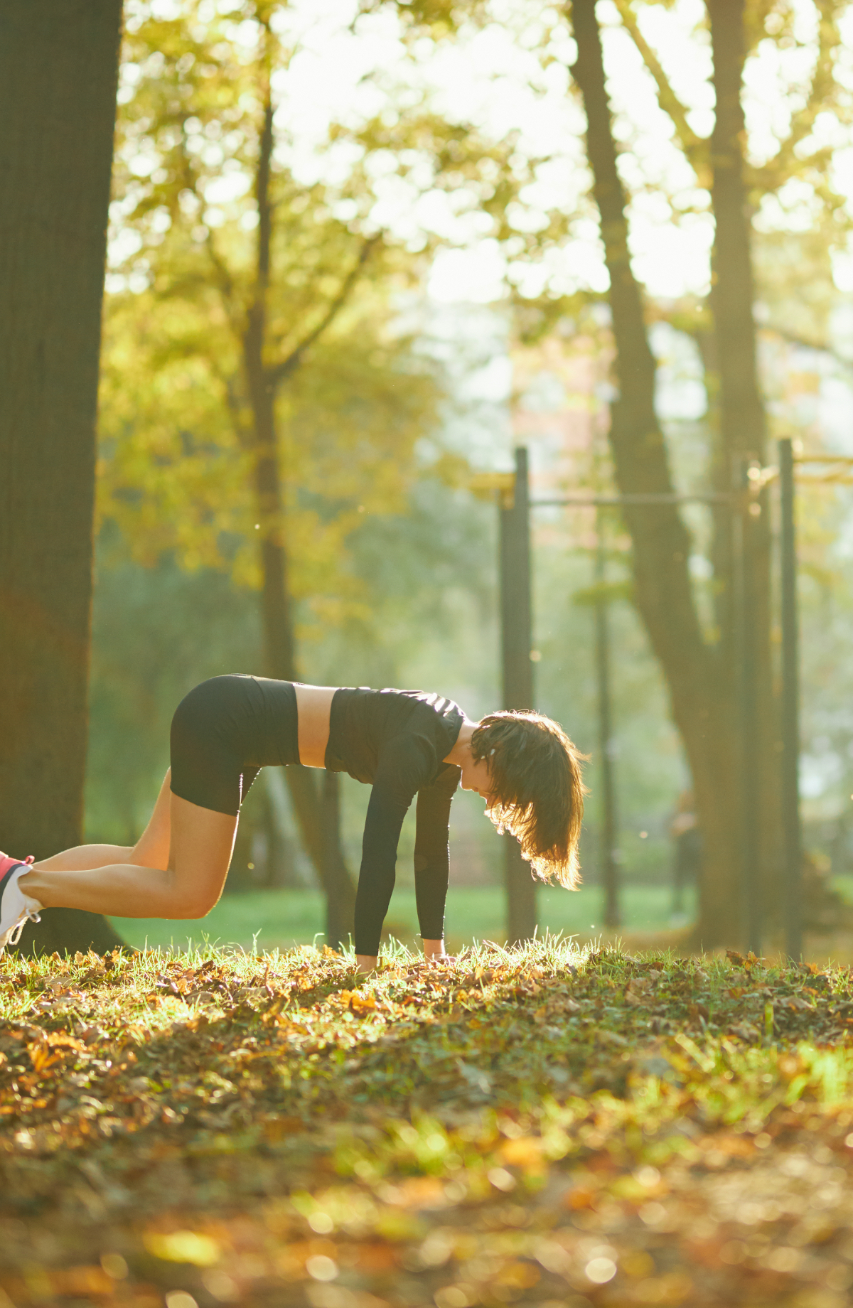 young-woman-performing-in-pilates-at-city-park